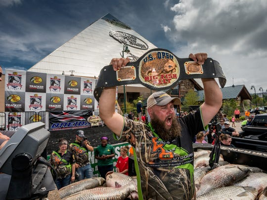 """Jason """"Gibby"""" Gibson celebrates after shooting the biggest fish yet at last year's Bass Pro Shops U.S. Open Bowfishing Championship in Memphis. His 70.4-pound grass carp has yet to be beaten during  a U.S. Open competition. The 2017 event is this weekend at five Missouri lakes."""