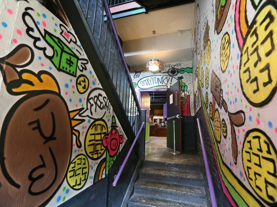 A colorful and funky entry way lead to Funk 'n Waffles in the former Water Street Music Hall.