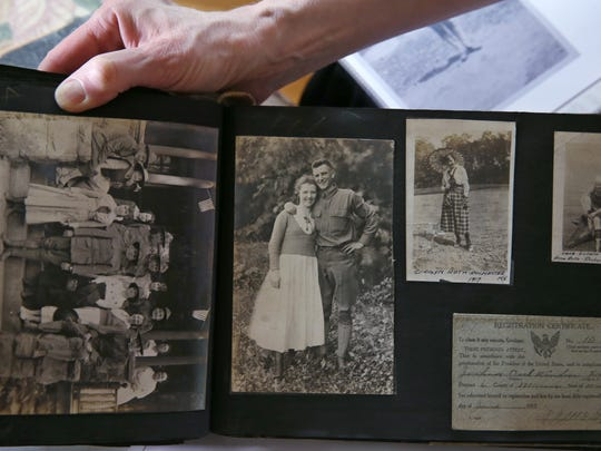 Sue Ellen Windsor looks over a diary and photo albums kept by her grandfather, J. Earl Windsor, during his time in Rochester during WWI when he was a student at the Aerial Photography School at Eastman Kodak, Tuesday, May 23, 2017, at her Penfield home.  The photo at center is her grandparents, J. Earl Windsor and wife Letha Windsor.