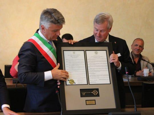 Pietrasanta, Italy, Mayor Massimo Mallegni presents Montgomery Mayor Todd Strange with a key to the city.