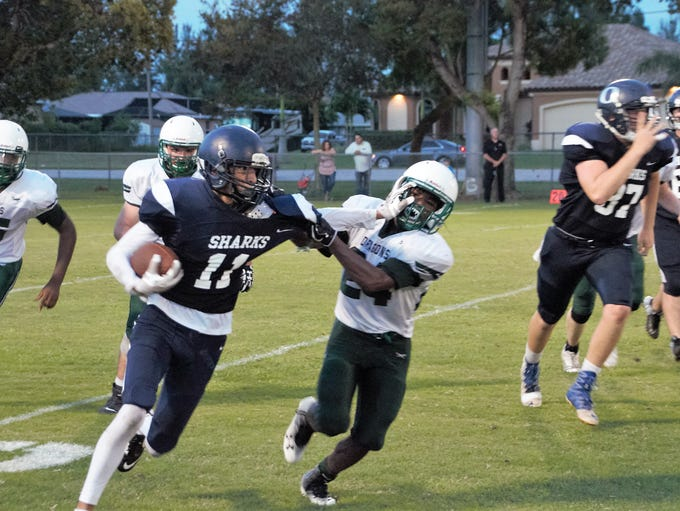 Oasis' Tristan Ramos carries the ball during the Sharks'