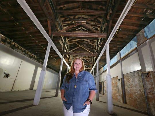 Kelli Berg, owner/curator inside the old Agway building