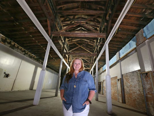 """Kelli Berg, owner/curator inside the old Agway building at 120 Railroad St. in Rochester Monday, Aug. 28, 2017.  Berg plans to renovate the building into """"Warehouse 127"""" as Railroad Street continues to undergo a transformation."""