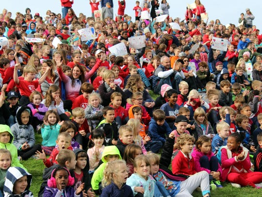 About 1,600 students and staff members from both Northside and Dudley Elementary schools in Fairport gathered on the hill behind the schools before embarking on the 2017 Fall Crawl.