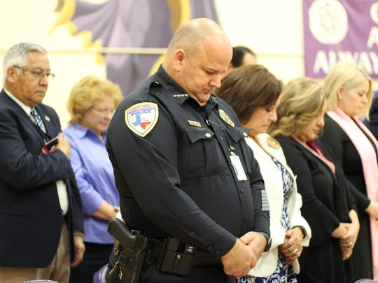 A moment of silence is observed by those who attended the Veterans Day Ceremony at Roy Miller High School on Friday.