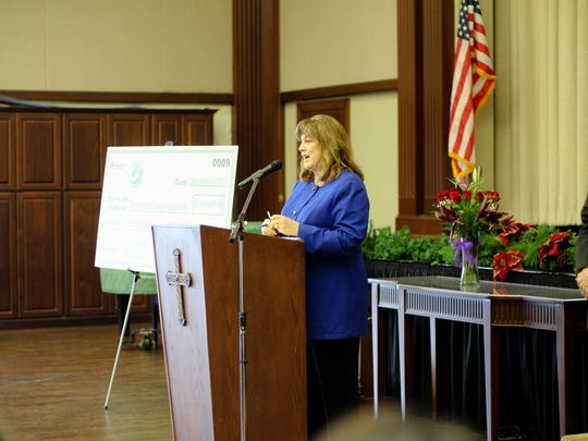 Karen W. Selim, President and CEO of the Coastal Bend Community Foundation, speaks at the Day of Giving event.