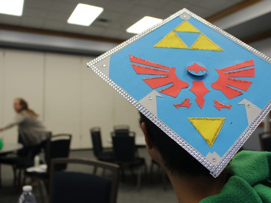 Florida Gulf Coast University student Noelani Brown shows off the Legend of Zelda inspired decoration on her graduation hat.