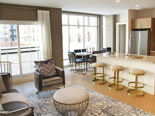 Residences at The Harper at Harmon Meadow feature bright, open layouts and ultra-modern kitchens with granite countertops and center islands.