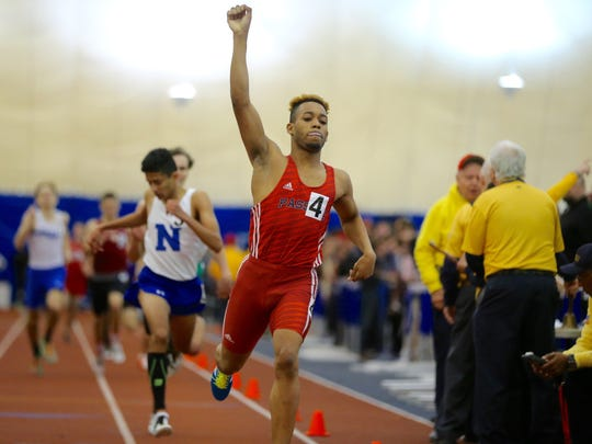 Luis Peralta of Passaic thrusts his first in the air after winning the 800 meters at the State Meet of Champions