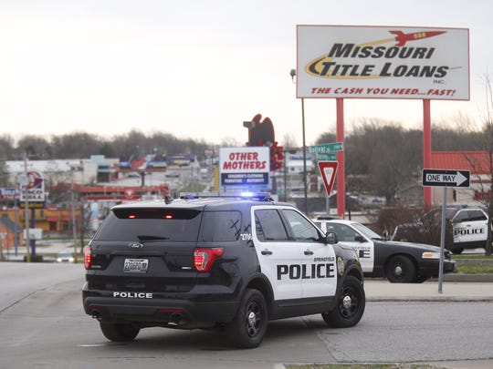 Police respond to an area near Kansas Expressway and