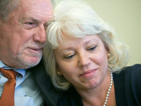 Debra Milke gets a hug from attorney Michael Kimerer during a 2015 press conference. Milke spent 24 years on death row before a federal appeals court threw out her conviction.