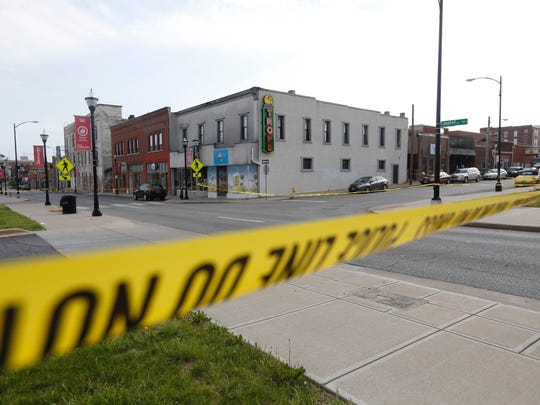 Springfield police continue to investigate the scene of a shooting outside of Tropical Liqueurs on Campbell Avenue on the morning of Saturday, May 19.