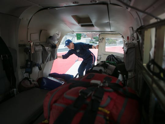 Gary Bollinger, nurse with Christiana Care's LifeNet, which provides emergency air transport to critically ill or injured adult, pediatric, and neonatal patients 24 hours a day, 7 days a week closes the rear doors of the helicopter.