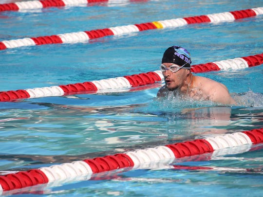 Swimmer Michael Lehrer represents Old Bridge, New Jersey in the 50th Special Olympics in Seattle, Washington from July 1 to 6.