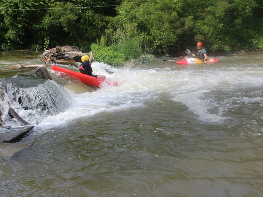 """Missy Rosenberry: """"Conquering the last of the three whitewater features, encouraged every step of the way by other kayakers in the water and on land."""""""
