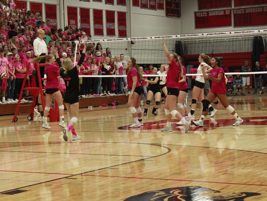 SPASH volleyball players celebrate winning a point