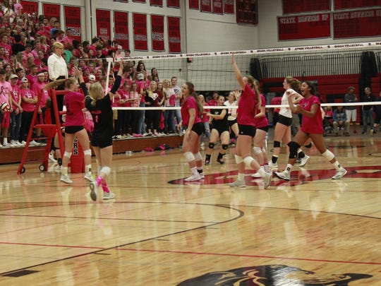 SPASH volleyball players celebrate winning a point against Wausau East during the eighth annual 'Diggin' the Cause' cancer event Thursday night.