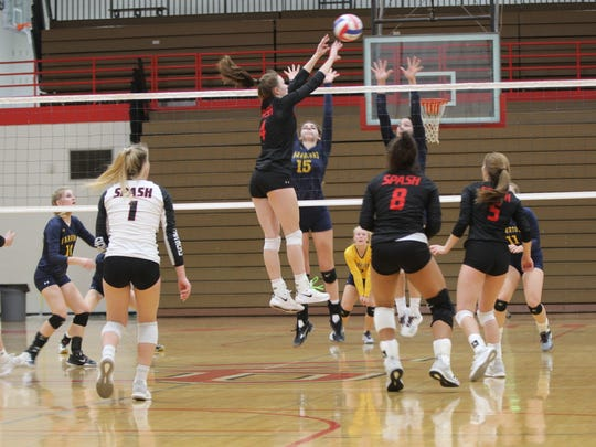 Wausau West's Maddie Hauer (15) and Maddy Dokken of SPASH joust at the net in their Division 1 sectional semifinal Thursday night in Wisconsin Rapids.