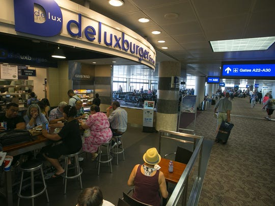 Delux in Terminal 4 is known for its juicy Neiman Ranch burgers and sweet-potato fries.