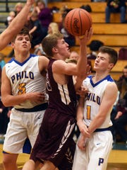 Parker Zachrich shoots over Philo's Trey Lutz in the