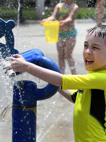 Silas Brown, 7, enjoys the splash pad at Carl Cowan