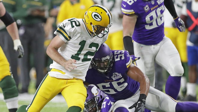 Green Bay Packers quarterback Aaron Rodgers (12) tries to recover his fumble after being stripped on a scramble against the Minnesota Vikings outside linebacker Anthony Barr (55) at U.S. Bank Stadium September 18, 2016.