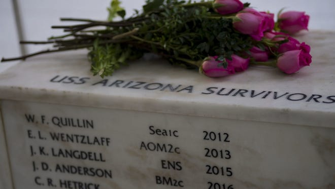 The names of John D. Anderson, boatswain's mate 2nd class, and Clarendon R. Hetrick, seaman 1st class, are added to the survivors inscription at the USS Arizona Memorial in Pearl Harbor, Hawaii, as part of their interment on the 75th anniversary of the attacks on Pearl Harbor.
