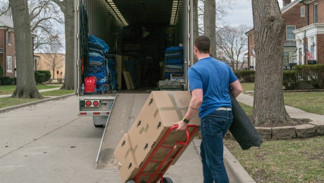 A moving contractor loads a moving truck with a service member's household goods during the permanent change of station peak-season at Scott Air Force Base, Ill. March 7, 2018.