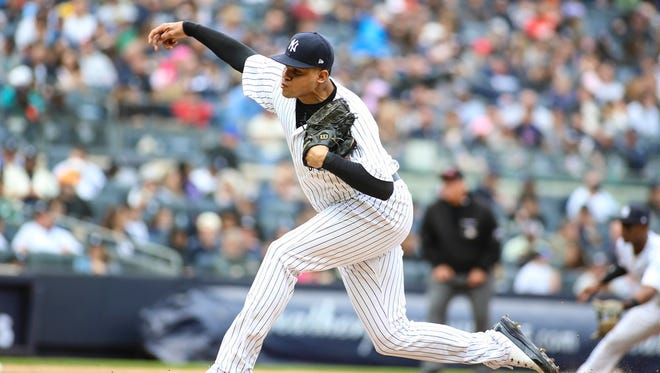 New York Yankees pitcher Dellin Betances (68) pitches in the seventh inning against the Cleveland Indians at Yankee Stadium.