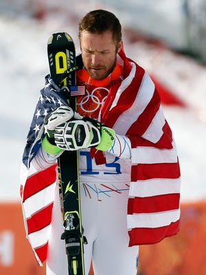 Bode Miller stands on the podium after winning bronze in men's alpine skiing super-G during the 2104 Sochi Winter Olympics.