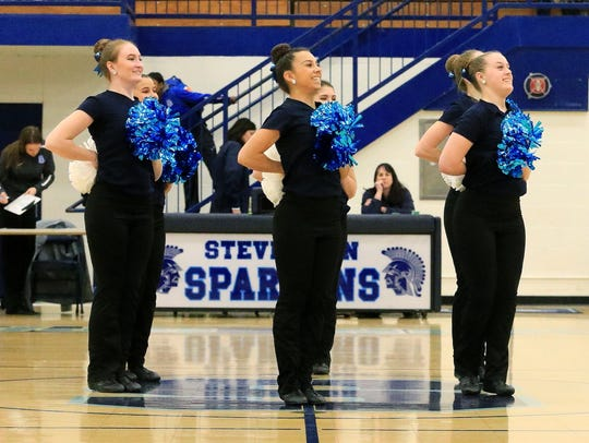 The Spartans pom squad works on precision routines,