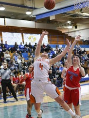 Northville's Roan Haines (4) attempts the shot in front