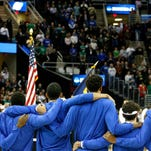The National Anthem is played before the Kentucky vs Notre Dame game.   March 28, 2015