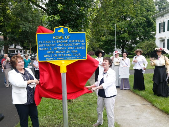 From left, Martha Sauerbrey and Emma Sedore reveal the historic marker to Elizabeth Browne Chatfield in Owego on Friday.  Chatfield was the private secretary to Susan B. Anthony from 1868-1871.  Sauerbrey is the chair of the Tioga County Legislature and Sedore is the Tioga County Historian.