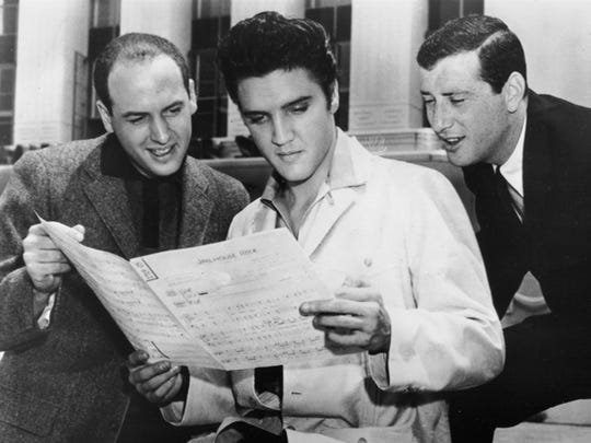 Elvis, with songwriters Mike Stoller, left, and Jerry Leiber, at MGM Studios, Culver City, Calif., in 1957