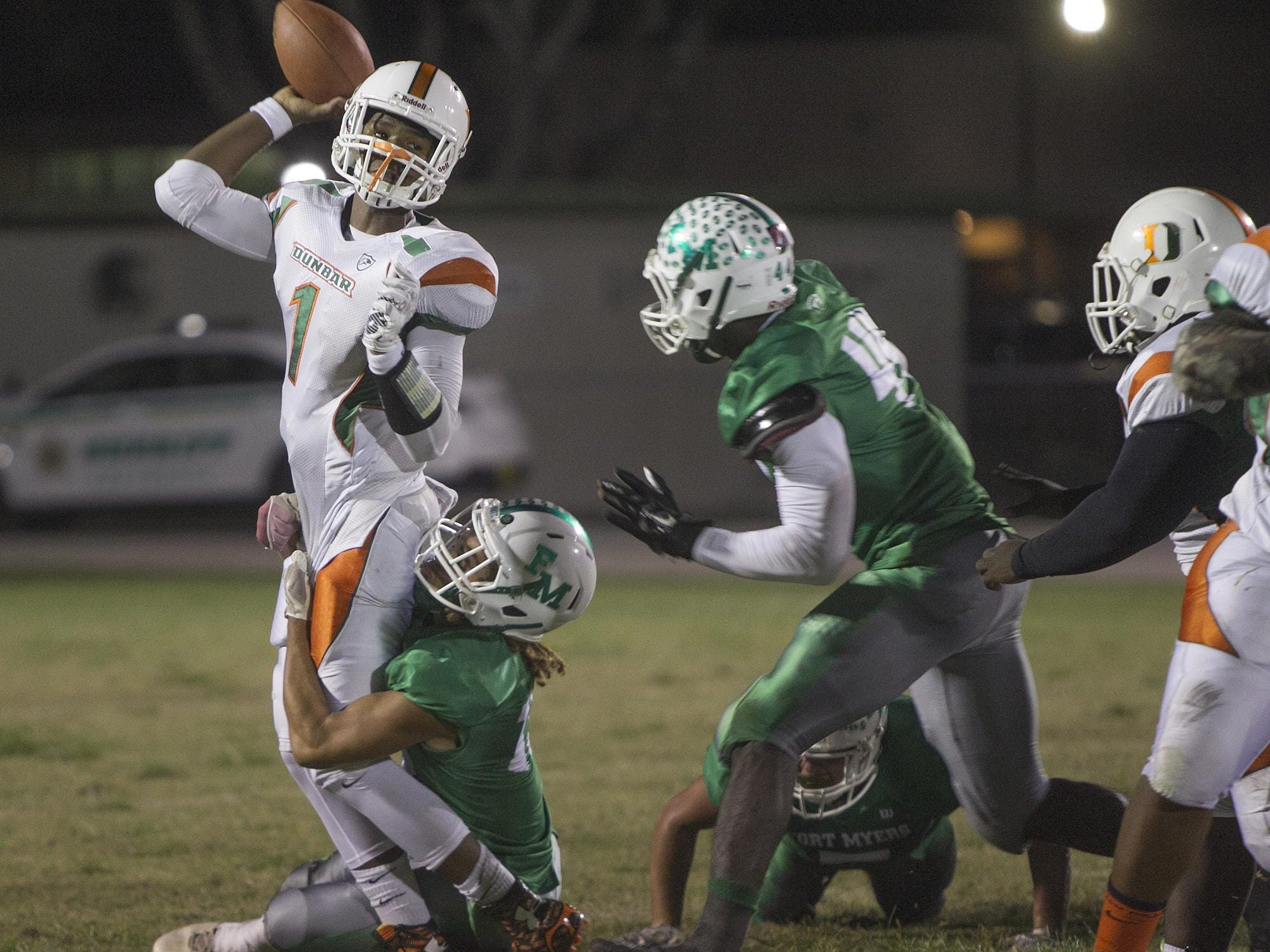 Dunbar QB Jairus Johnson is wrapped up by Fort Myers defender Eddie Ferguson Friday at Sam Sirianni Field in Fort Myers. The pass was incomplete.