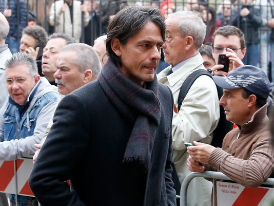 Former AC Milan player Filippo Inzaghi attends the funeral of former Italy coach Cesare Maldini funeral, in Milan's Sant'Ambrogio's Basilica, Italy, Tuesday, April 5, 2016.  Maldini, who was also an AC Milan player and coach, died over the weekend at the age of 84.(AP Photo/Antonio Calanni)
