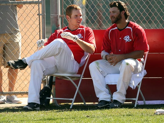 Tommy Barksdale (6, right) talks with a Palm Springs Power teammate on Monday, February 9, 2015 during their game against the Palm Springs Chill in Palm Springs, Calif. Barksdale is nearly deaf, but reads lips and talks while conversing with coaches and teammates.