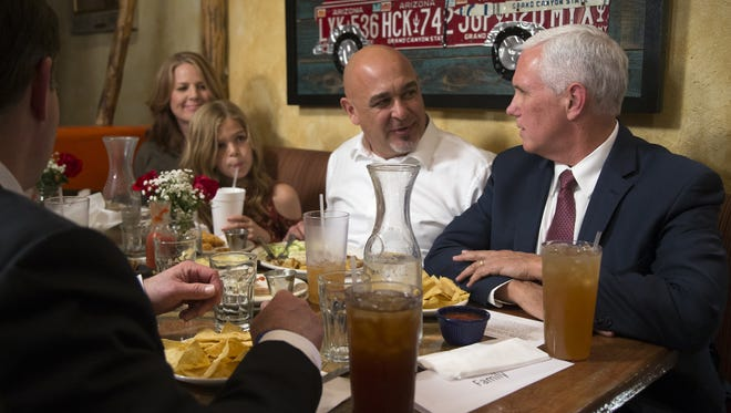 Vice President Mike Pence (right) talks with Scott Gonzalez (2nd from right), on Tuesday, Oct. 3, 2017, at Ajo Al's, 5101 N 16th St, Phoenix.