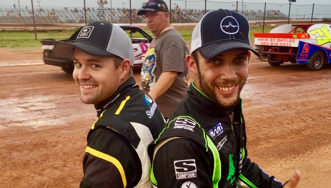 Ricky Stenhouse Jr. and Bryan Clauson sit back to back. Clauson died last August, and Stenhouse has promised to be there for his family.