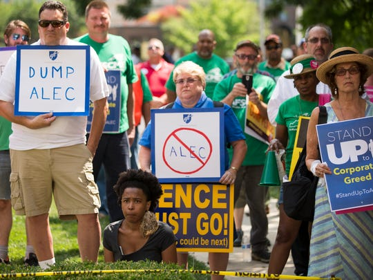 An estimated 175 people assembled at the Indiana Statehouse on Wednesday, July 27, 2016, to protest ALEC, which is holding its annual conference at the JW Marriott in Downtown Indianapolis.