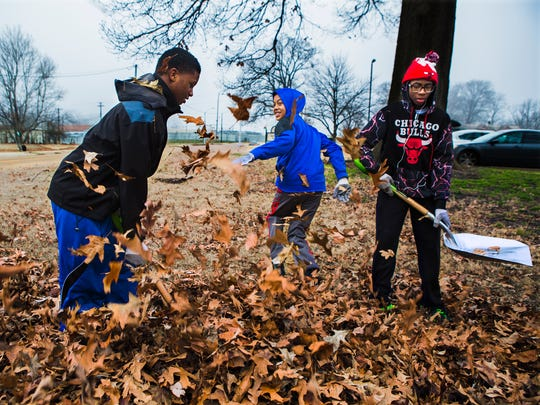 "(Left to right) Gaston Gators basketball teammates Kyler Jones, 13; Zenterius Wilson, 12; and Puncho Jefferies, 14, have fun tossing leaves at each other as they participate in the ""We Love Gaston"" Community Clean Up Project for the MLK Days of Service at the Gaston Community Center on Saturday, Jan. 14, 2017."
