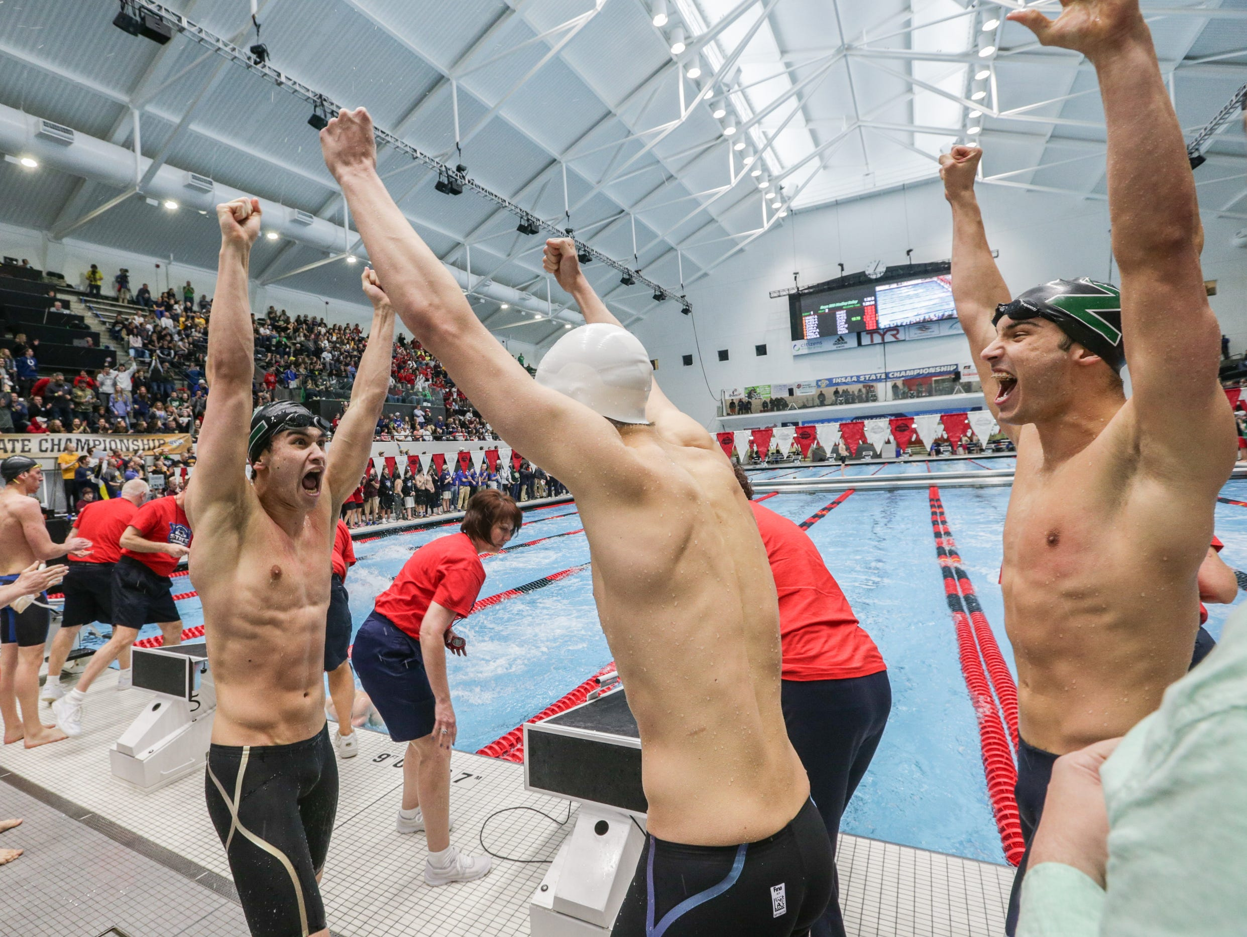 Zionsville's 200 yard medley team celebrates a win during the 2017 IHSAA High School Boys Swimming and Diving State Finals, held at the IUPUI Natatorium, Feb. 25, 2017.