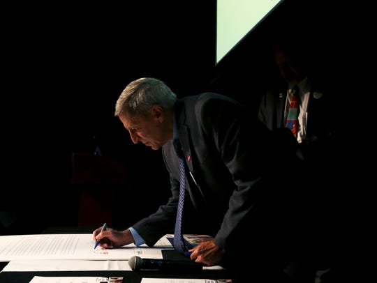 John Smarrelli, Jr., president of Christian Brothers University, signed a letter of support for the Dream Act at a Nov. 15 ceremony.