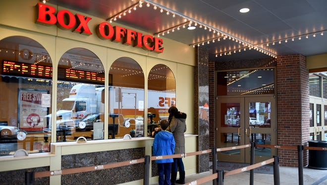 Customers purchase tickets from the box office at the Regal Riviera theater on Gay Street Friday, Jan. 15, 2016.