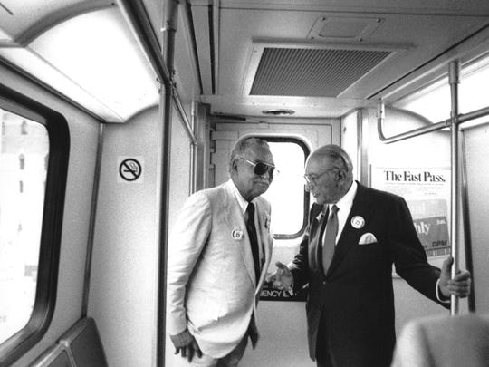 Detroit Mayor Coleman Young, left, and industrialist Max Fisher on the People Mover in downtown Detroit in July 1987.