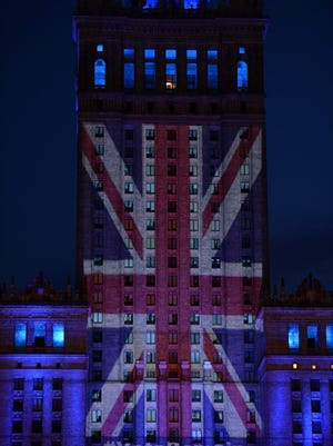 British flag displayed on the facade of the Palace of Culture and Science in Warsaw, Poland.