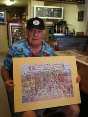 Gregg Sheesley displays this year's Silverton Sidewalk Shindig poster as he visits the Creekside Chat at Silver Creek Coffee House.