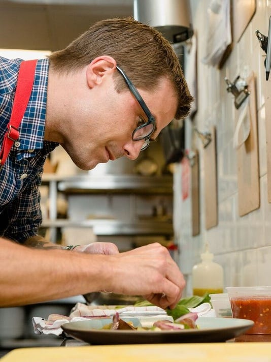 636317535877854785-Hugh-Acheson-in-kitchen-2.jpg
