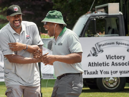 Adam Beasley, left, and Blair Thomas goof around before the 30th Annual Eddie Khayat & George Tarasovic Celebrity Golf Classic supporting York County Special Olympics on Monday. Thomas played football for Penn State and the New York Jets. Beasley, born in Pottstown, played for the Jacksonville Jaguars in the 1996 NFL draft.